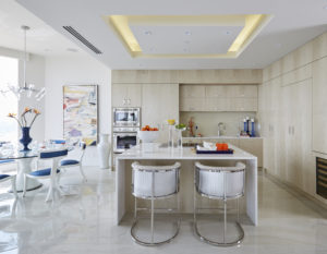 Contemporary kitchen with an open concept floor plan and integrated appliances.