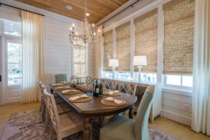 Coastal Dining Room with Roman Shades, White Draperies, and Shiplap